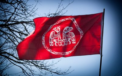 kwekwecnewtxw–protect-the-Inlet-march-10-a-first-nations-flag-in-red-and-white-2500px