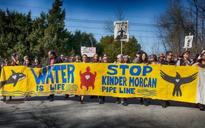 kwekwecnewtxw–protect-the-Inlet-march-10-lead-marchers-with-bright-yellow-water-is-life-banner-3000px